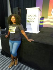 Mary Job posing for a camera at SMWLagos19 Stage